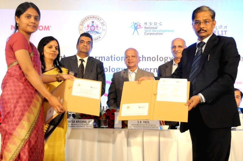 Tanushree Deb Barma, Director, Directorate of ITBT  exchanges Memorandum of Understanding (MoU) with MD of National Institute of Electronics and Information Technology, Ashwin Kumar Sharma in ... - S R Patil and Ashwin Kumar Sharma