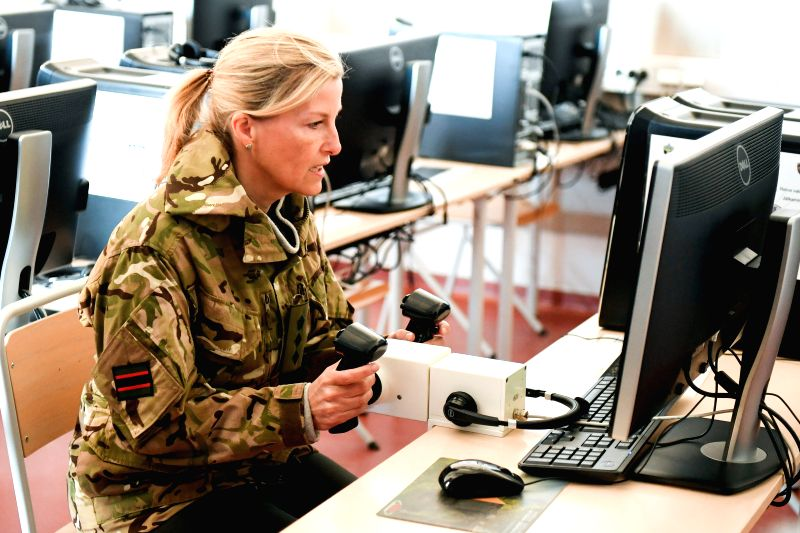 TAPA, May 3, 2017 - Sophie, Countess of Wessex, drives an armoured vehicle on the computer simulation system at Tapa Army Base in northern Estonia, May 3, 2017. The countess visited Wednesday the ...