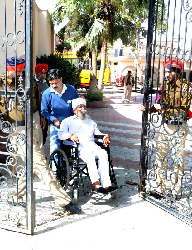 Tarn Taran: A physically challenged voter arrives to cast his vote at a polling booth during Punjab civic body polls in Tarn Taran near Amritsar, on Feb 25, 2015.
