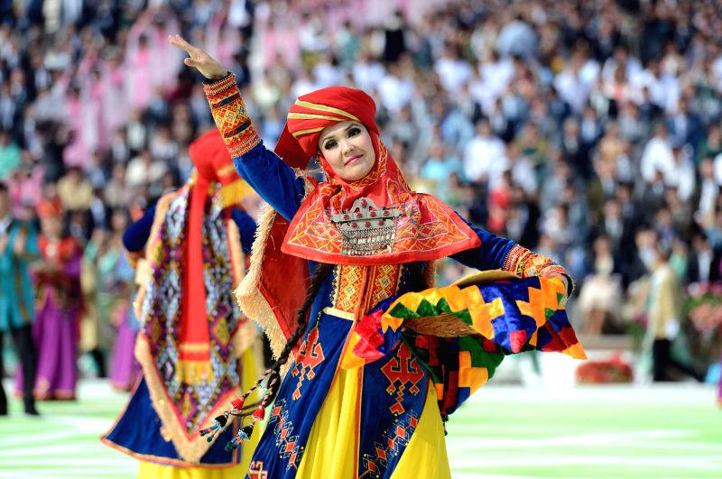 Dancers perform at Nowruz festival celebration in Tashkent, Uzbekistan on March 21, 2015. Nowruz is a traditional festival which celebrates the coming of spring. ...