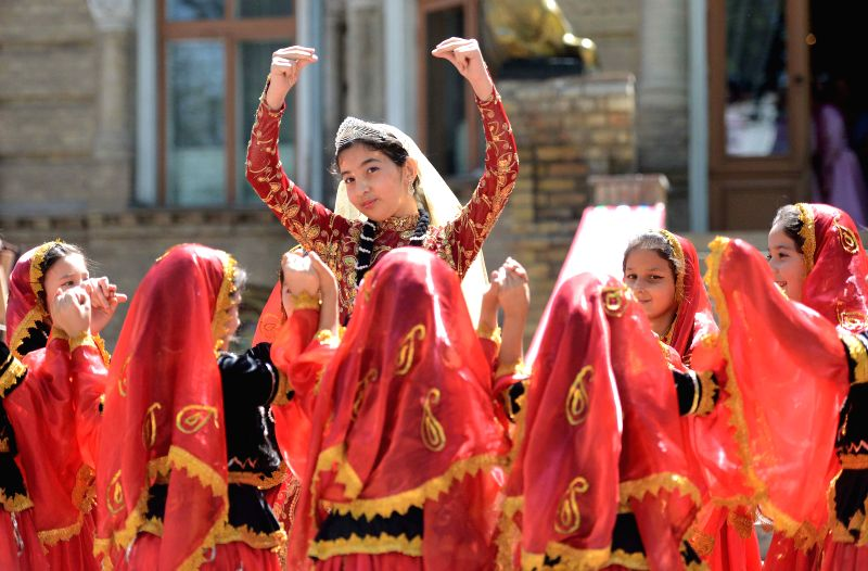 Performers from Azerbaijani embassy dance during the 12nd Uzbekistan foreign mission traditional culture and folk cuisine feast in Tashkent, Uzbekistan, May 10, ...