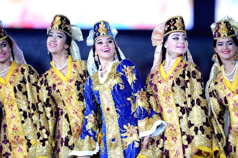 Dancers perform during the Independence Day celebration in Tashkent, capital of Uzbekistan, on Aug. 31, 2014. Uzbekistan celebrated its 23rd Independence Day ...