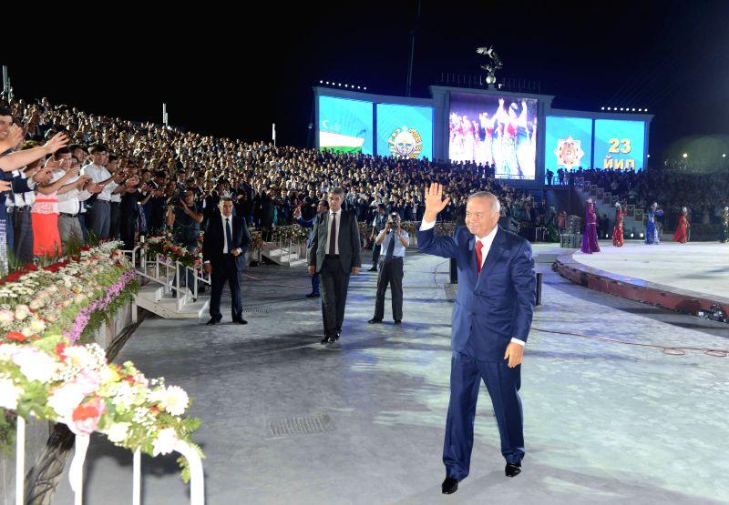 Uzbek President Islam Karimov waves to audience during the Independence Day celebration in Tashkent, capital of Uzbekistan, on Aug. 31, 2014. Uzbekistan celebrated