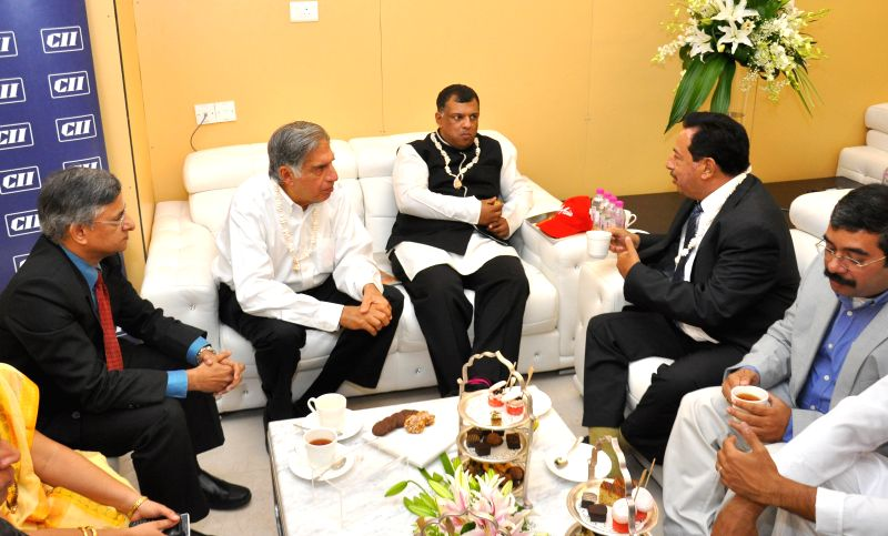 Tata group Chairman Emeritus Ratan Tata and AirAsia Group Chief Executive officer Tony Fernandes with Goa Deputy Chief Minister Francisco D'Souza suring a meeting regarding AirAsia Airlines at ... - Francisco D and Tony Fernandes