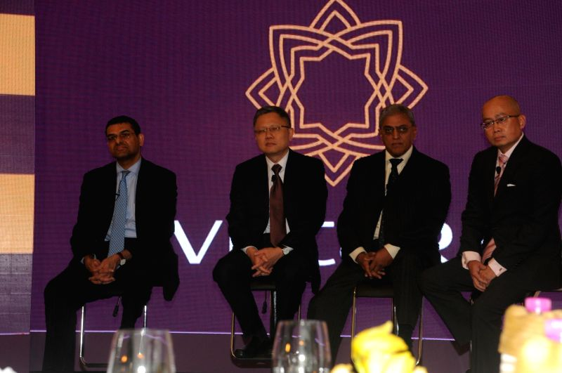 Tata-SIA Airlines chairman Prasad Menon and board directors Mukund Rajan and Swee Wah Mak and CEO, Tata SIA Airlines Ltd., Phee Teik Yeoh during announcement of the brand name of Tata Sons-Singapore . - Prasad Menon