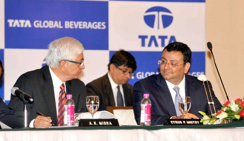 Tata Sons Chairman, Cyrus P Mistry with Managing Director and CEO of Tata Global Beverages Ajoy Mishra during Tata Global Beverages' 51st Annual General Meeting in Kolkata on Aug 26, 2014.