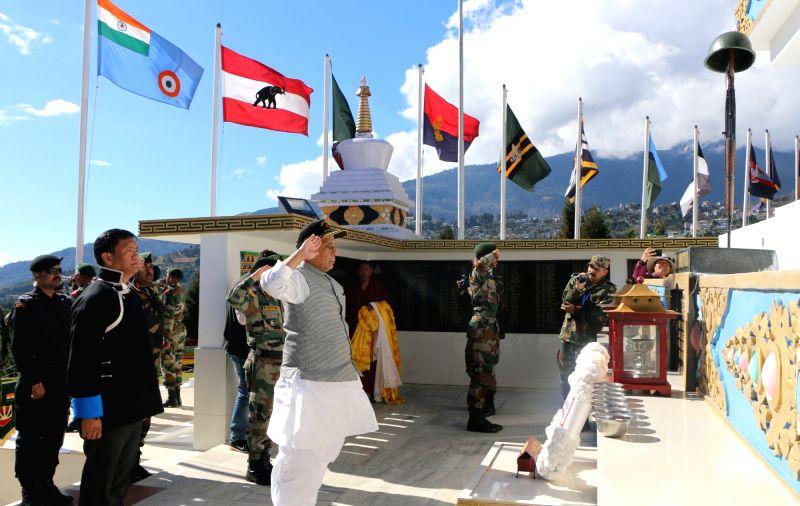 Tawang: Defence Minister Rajnath Singh and Arunachal Pradesh Chief Minister Pema Khandu offer tributes to the fallen soldiers who made their supreme sacrifice during the War of 1962, at Tawang War Memorial in Arunachal Pradesh's Tawang on Nov 14, 201