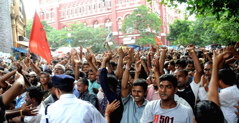 Taxi drivers celebrate as their 21 colleagues got bail from Bankshall Court in Kolkata on Aug 12, 2014.