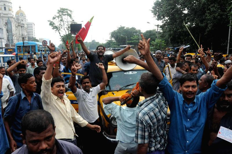 Taxi drivers demonstrate against police atrocities in Kolkata on Aug 7, 2014.