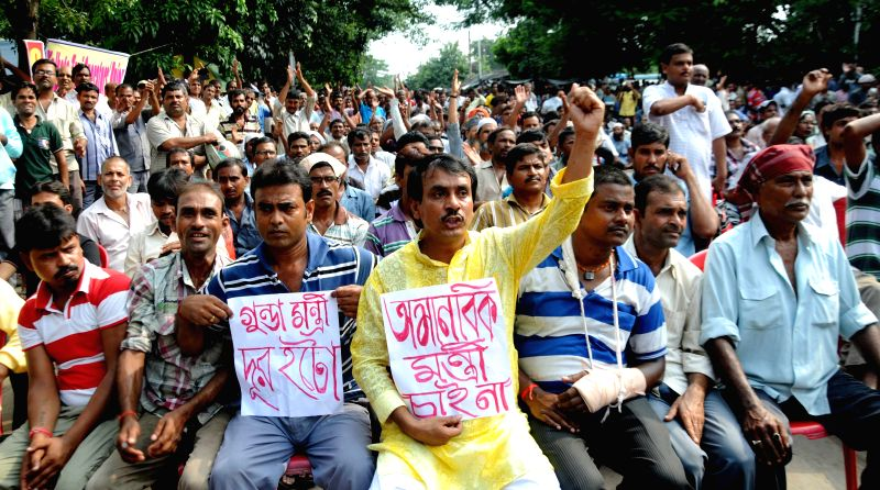 Taxi drivers demonstrate against police atrocities in Kolkata on Aug 18, 2014.