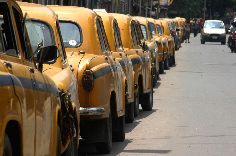 Taxis remain parked in their stands as taxi drivers go on a strike in Kolkata on Aug 18, 2014.