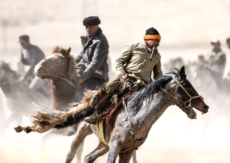 Horsemen of the Tajik ethnic group attend Buzkashi competition in Tizinafu Township of Taxkorgan Tajik Autonomous County, northwest China's Xinjiang Uygur ...