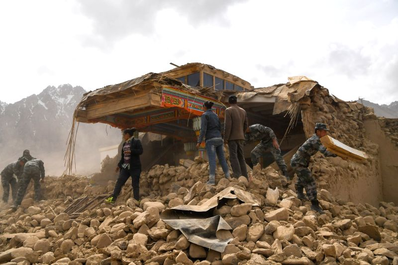 TAXKORGAN, May 11, 2017 - Rescuers work in Quzgun Village in quake-hit Taxkorgan County, northwest China's Xinjiang Uygur Autonomous Region, May 11, 2017. Eight fatalities have been confirmed and 23 ...