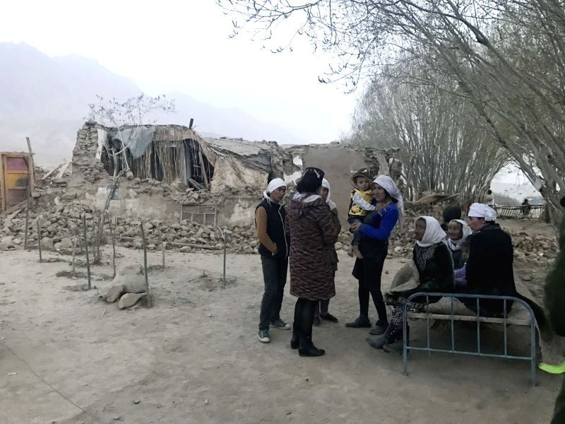 TAXKORGAN, May 11, 2017 - Residents are seen outside damaged houses at Kuzigun Village in Taxkorgan County, northwest China's Xinjiang Uygur Autonomous Region, May 11, 2017. Eight people have been ...