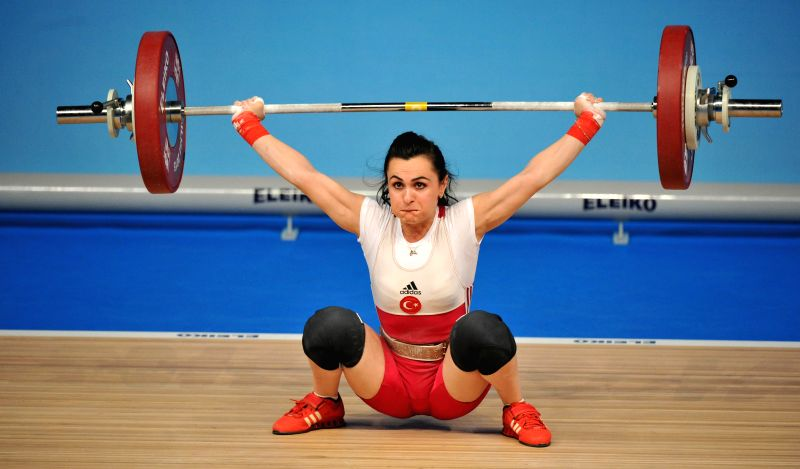 Nurcan Taylan of Turkey competes during the women's 48kg clean and jerk final of the European Weightlifting Championship in Tbilisi, Georgia, April 11, 2015. ...