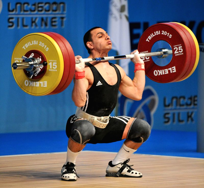Valentin Hristov of Azerbaijan competes during the men's 62kg final of the European Weightlifting Championship in Tbilisi, Georgia, April 12, 2015. Hristov took ...