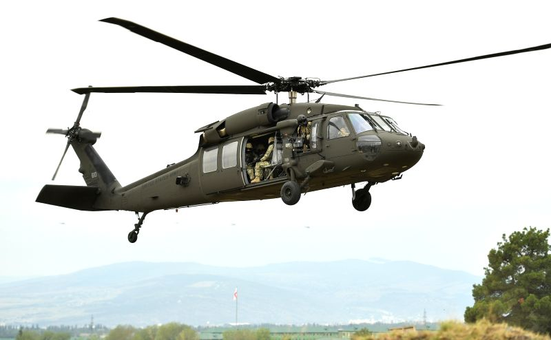 """TBILISI, Aug. 10, 2018 - A helicopter is seen during the combined field exercise of the multinational military drill named """"Noble Partner 2018"""" at Vaziani base near Tbilisi, Georgia, Aug. ..."""