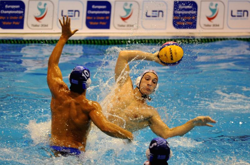 Imnaishvili (R) of Georgia competes during the match between Greece and Georgia at the Men's Under-19 European Waterpolo Championship held in Tbilisi, Georgia, on ..