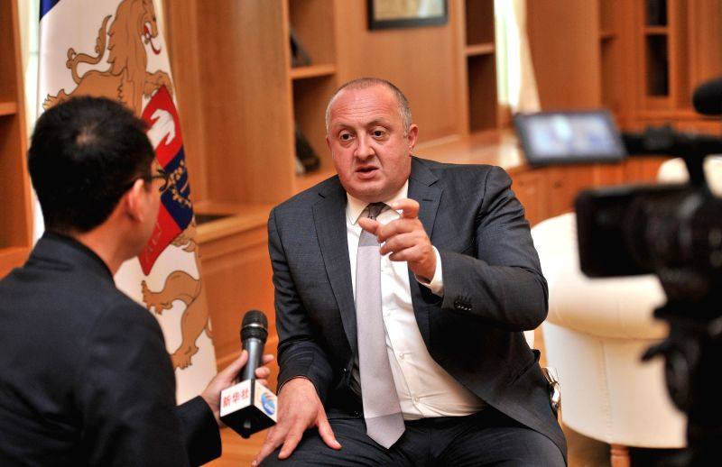 TBILISI, June 11, 2018 - Georgian President Giorgi Margvelashvili (R) speaks during an exclusive interview with Xinhua News Agency in Tbilisi, Georgia, June 8, 2018. Georgia believes China's ...