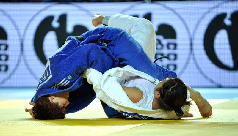 Tsedevsuren Munkhzaya of Mongolia(R) competes against Trestenjak Tina of Slovenia during women's 63kg match of Judo Grand Prix Tbilisi 2015 in Tbilisi, Georgia, ...