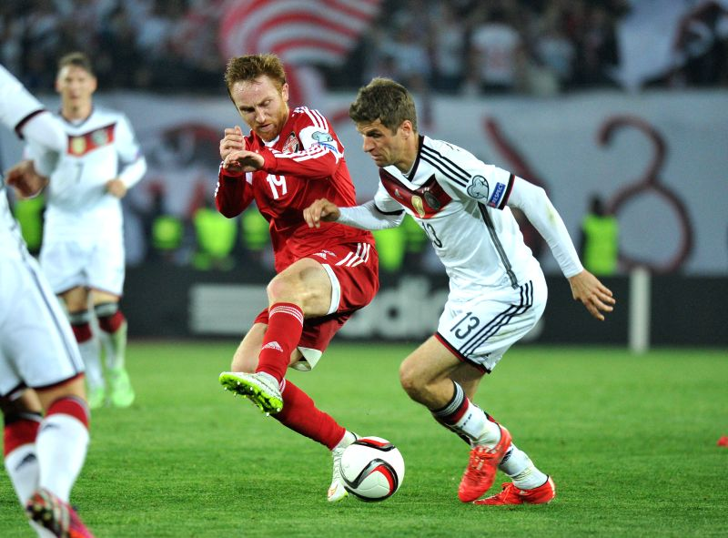 Thomas Muller (R) of Germany vies with Sandro Kobakhidze of Georgia during their UEFA Euro 2016 Group D qualifying match at Mikheil Meskhi stadium in Tbilisi, ...