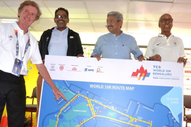 TCS World 10K Race Director Hugh Jones with Fortis Hospital Medical Director Dr. Vivek Jawali, Procam International Operation Head PN Sankaran unveils the TCS World 10K Race Route Map ...