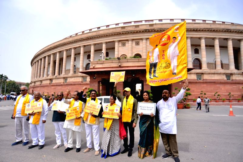 TDP MPs stage a demonstration at Parliament to press for their demands in New Delhi on Aug 3, 2018.