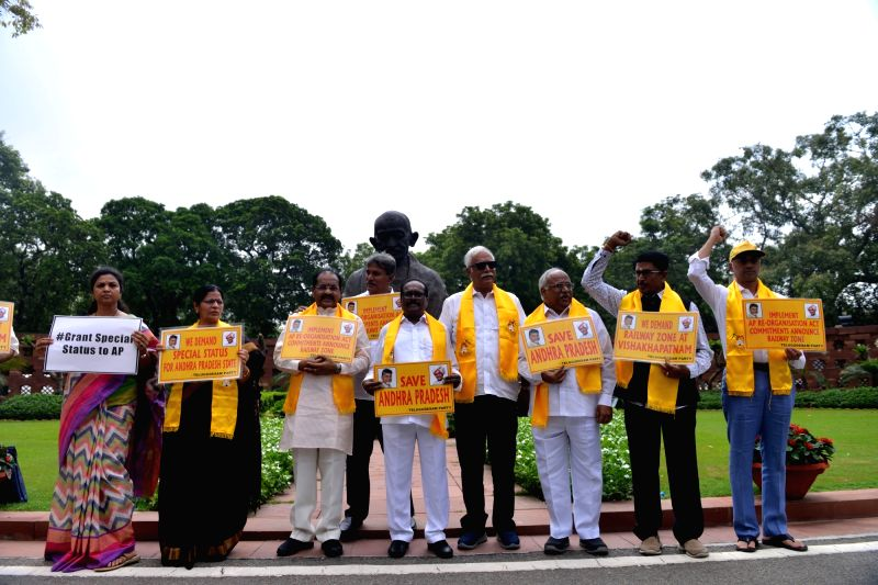 TDP MPs stage a demonstration to press for their various demands including special status for Andhra Pradesh at Parliament in New Delhi on July 23, 2018.