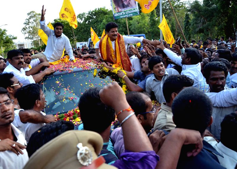 TDP workers celebrate outside the Cherlapally Central Jail after TDP MLA Revanth Reddy being released on conditional bail by the Hyderabad High Court in the cash-for-vote case in Hyderabad ...