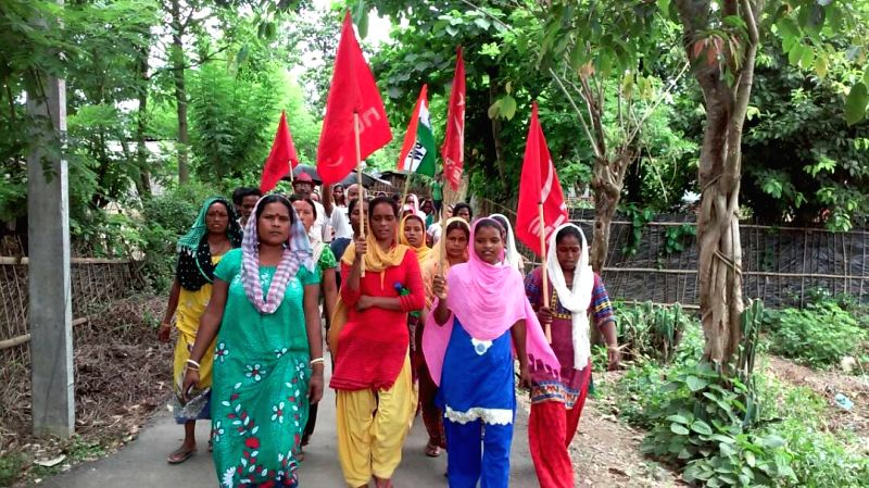 Tea Garden workers participate in a rally in Alipurduar after the joint forum of trade unions of the tea industry in north Bengal began a two-day industrial strike, demanding ...