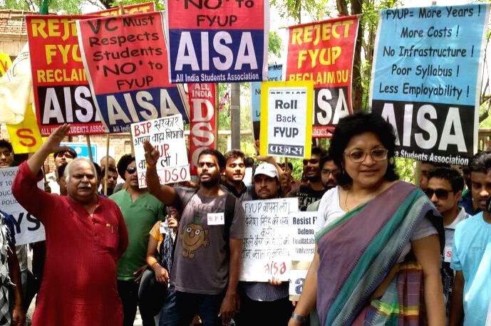 Teachers affiliated to Delhi University Teachers' Association (DUTA) and students affiliated to various students' union demonstrate against FYUP in New Delhi on June 19, 2014.