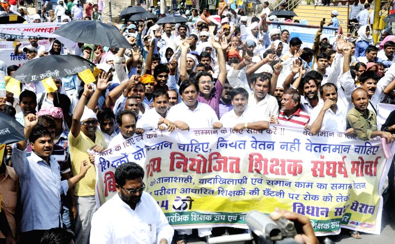 Teachers demonstrate to press for their various demands in Patna on July 15, 2014.