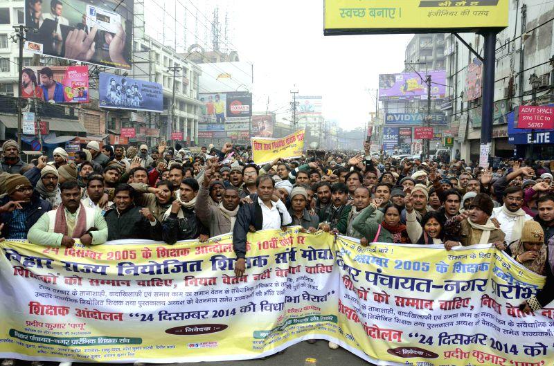 Teachers stage a demonstration near Bihar Assembly in Patna on Dec 24, 2014.