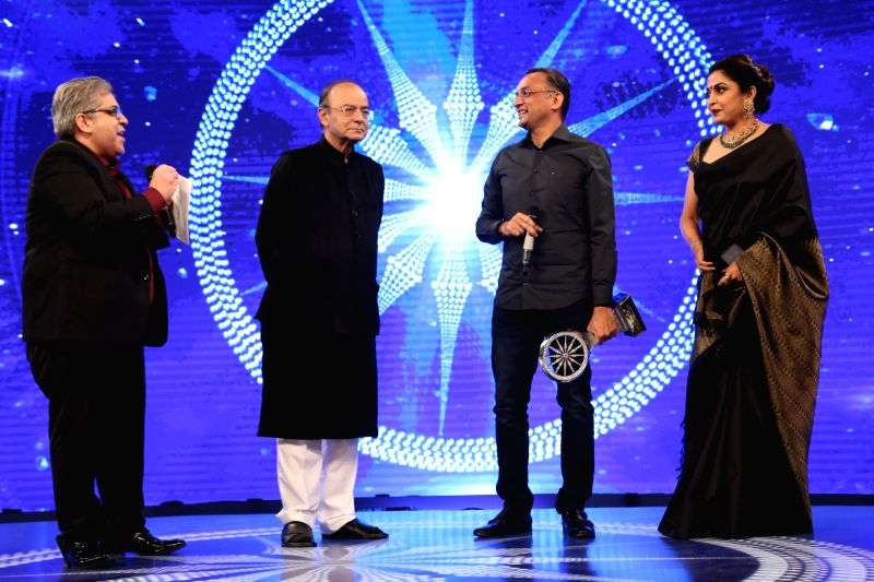 Team Baahubali's Ramya Krishna and Shobu Yarlagadda during Indian of the Year 2017 award ceremony hosted by CNN News 18 in New Delhi, on Nov 30, 2017. Outstanding achievment award goes to ... - Arun Jaitley