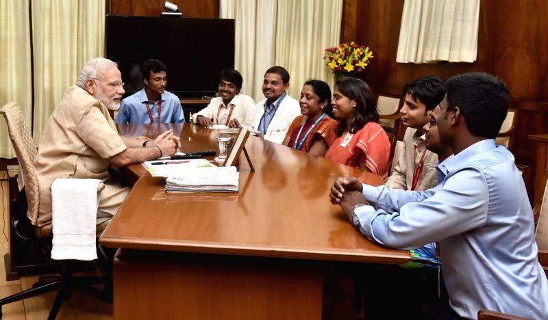 """Team of students involved in building satellite """"Sathyabama-sat"""" calls on the Prime Minister, Narendra Modi, in New Delhi on July 19, 2016. - Narendra Modi"""