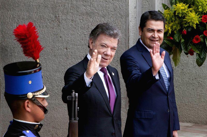 TEGUCIGALPA, April 6, 2016 - Honduras' President Juan Orlando Hernandez (R) receives his Colombian counterpart Juan Manuel Santos (C), in Tegucigalpa, capital of Honduras, on April 6, 2016. Juan ...