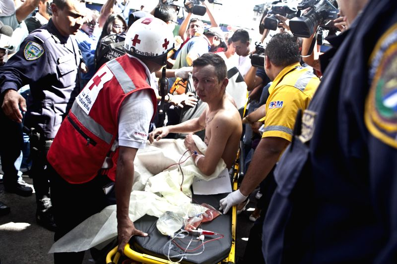 A person recieves medical treatment after an explosion in a market, in the University Teaching Hospital (HEU, for its acronym in Spanish), in Tegucigalpa, ...