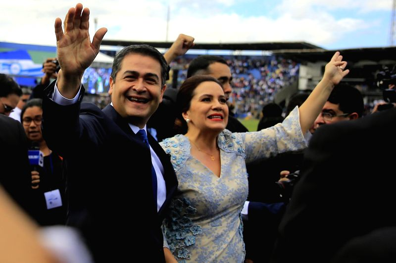 TEGUCIGALPA, Jan. 28, 2018 - Honduran President Juan Orlando Hernandez (L) and his wife Ana Garcia (R) take part in a ceremony of inauguration held in the National Stadium in Tegucigalpa, capital of ...