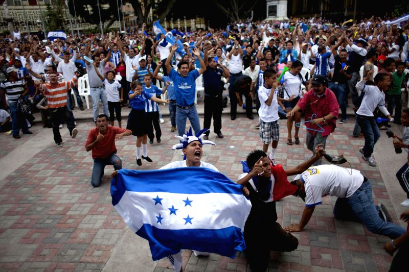Fans of Honduras celebrate a goal while watching a Group E match between Honduras and Ecuador of 2014 FIFA World Cup, at the Central Park of Tegucigalpa, in ...