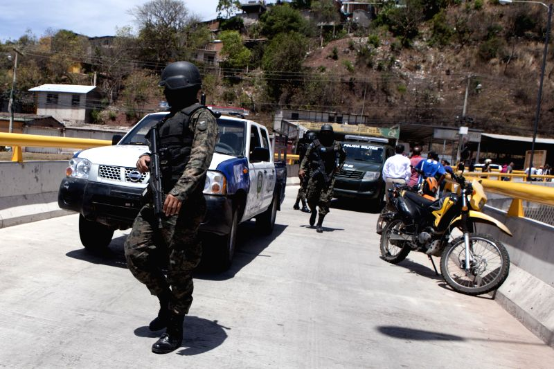 Honduran authorities inspect the site of the homicide of three women, in Tegucigalpa, Honduras, on March 15, 2015. According to local press, data from the ...