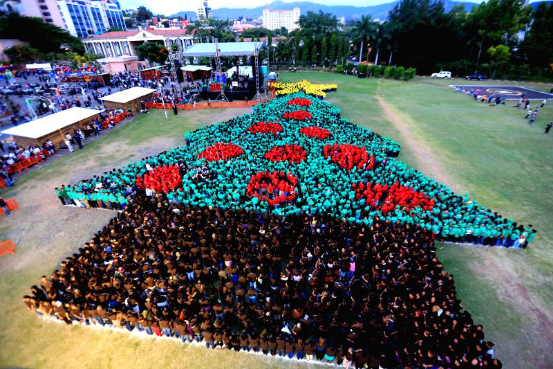Photo provided by Honduras Presidency shows people participating in the event to break a Guinness Record for world's biggest human Christmas tree, at Democracy Square of Presidential ...