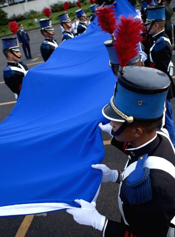 Cadets of the military school Francisco Morazan take part in a flag-raising ceremony to kick off celebrations marking the Independence Day, in Tegucigalpa, ...
