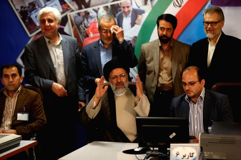 TEHRAN, April 15, 2017 - Iranian senior principlist cleric Ebrahim Reisi (C) gestures as he registers for the upcoming presidential race at the Interior Ministry in Tehran, capital of Iran, on April ... - Hassan Rouhani