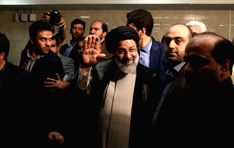 TEHRAN, April 15, 2017 - Iranian senior principlist cleric Ebrahim Reisi (C) leaves after registering for the upcoming presidential race at the Interior Ministry in Tehran, capital of Iran, on April ... - Hassan Rouhani