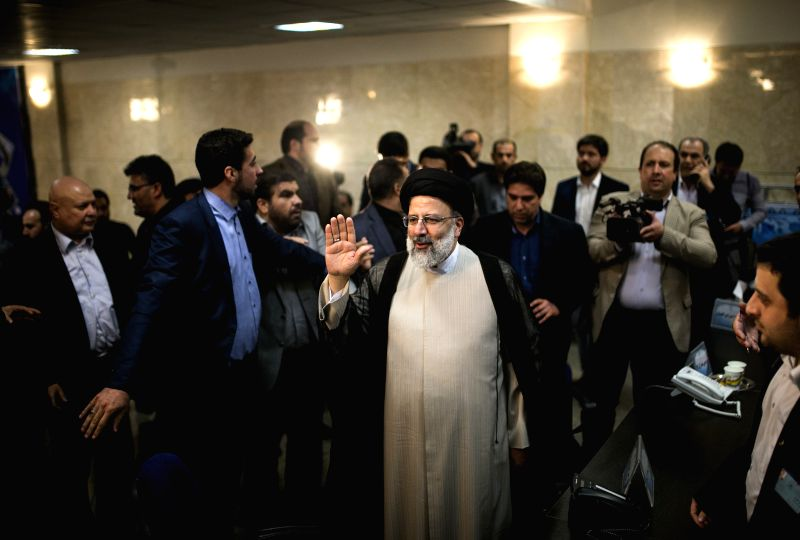 TEHRAN, April 15, 2017 - Iranian senior principlist cleric Ebrahim Reisi (Down) shows his identification as he registers for the upcoming presidential race at the Interior Ministry in Tehran, capital ... - Hassan Rouhani