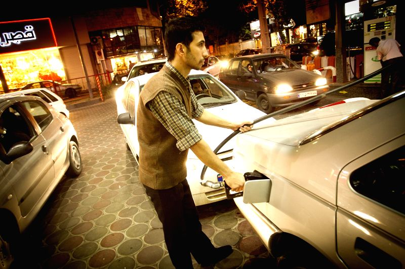 A man refuels his car at a gas station in Tehran, capital of Iran, on April 22, 2014. After Iranian officials announced an increase in fuel prices in days to come ..