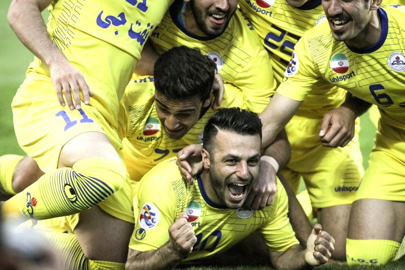 Players of Iran's Naft celebrate during a Group B match with Uzbekistan's Pakhtakor of the Asian Champions League at Azadi Stadium in Tehran, Iran, April 22, 2015. ...