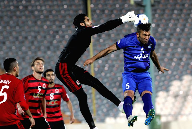 Hanif Omran Zadeh (R) of Iran's Esteghlal vies with Abdullah Alhajri of Qatar's Al-Rayyan during their AFC Champions League Group A preliminary match in Tehran, ...