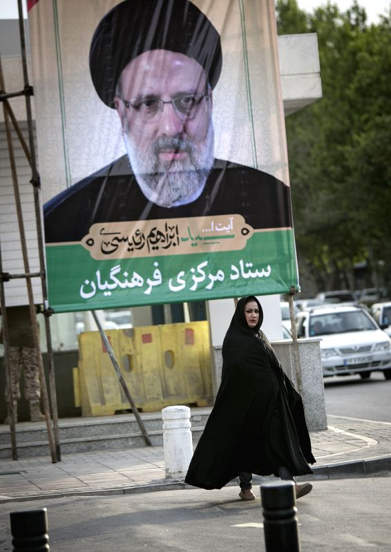 TEHRAN, April 29, 2017 - A woman walks past a poster of Iranian Presidential candidate Ebrahim Reisi at a street in Mashhad city, northeastern Iran, on April 29, 2017. Iranian senior principlist ...
