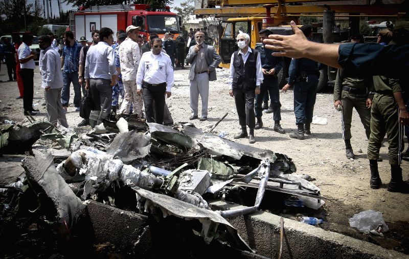 Wreckage of a plane is seen near Tehran, Iran on Aug. 10, 2014. A passenger plane crashed on the outskirts of Iran's capital Tehran on Sunday morning, killing all ...